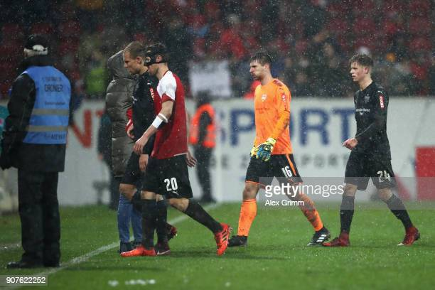 Holger Badstuber Christian Gentner RonRobert Zieler and Dzenis Burnic of Stuttgart leave the pitch after the Bundesliga match between 1 FSV Mainz 05...