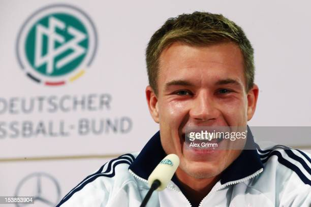 Holger Badstuber laughs during a Germany press conference ahead of their FIFA 2014 World Cup group C qualifying match against Ireland at...