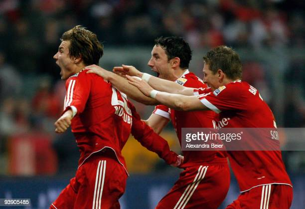 Holger Badstuber Marc van Bommel and Bastian Schweinsteiger of Bayern Muenchen celebrate Badstuber's goal during the Bundesliga match between FC...