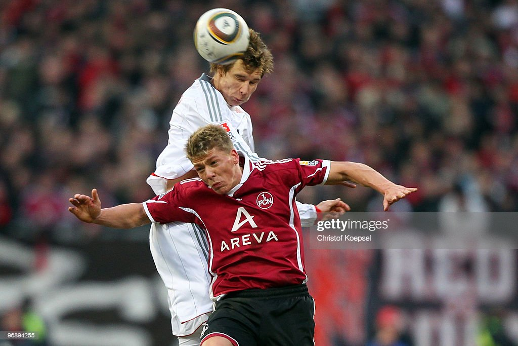 Holger Badstuber of Bayern and Mike Frantz of Nuernberg jump for a header during the Bundesliga match between 1. FC Nuernberg and FC Bayern Muenchen at Easy Credit Stadium on February 20, 2010 in Nuremberg, Germany.