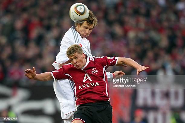 Holger Badstuber of Bayern and Mike Frantz of Nuernberg jump for a header during the Bundesliga match between 1 FC Nuernberg and FC Bayern Muenchen...