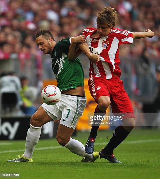 Holger Badstuber of Bayern fights for the ball with Marko Arnautovic of Bremen during the Bundesliga match between FC Bayern Muenchen and SV Werder...