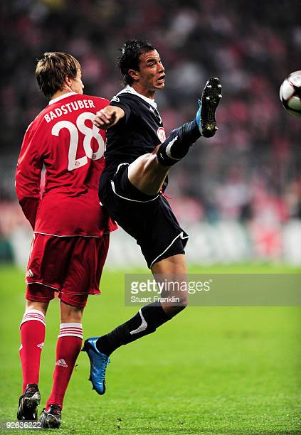 Holger Badstuber of Bayern is challenged by Marouane Chamakh of Bordeaux during the UEFA Champions League Group A match between FC Bayern Muenchen...