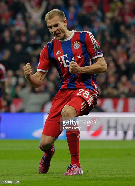 Holger Badstuber of Bayern Muenchen celebrates as he scores their fifth goal during the UEFA Champions League Round of 16 second leg match between FC...