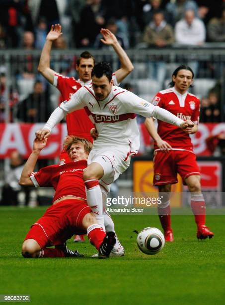Holger Badstuber of Bayern Muenchen fights for the ball with Timo Gebhart of Stuttgart during the Bundesliga match between FC Bayern Muenchen and VfB...