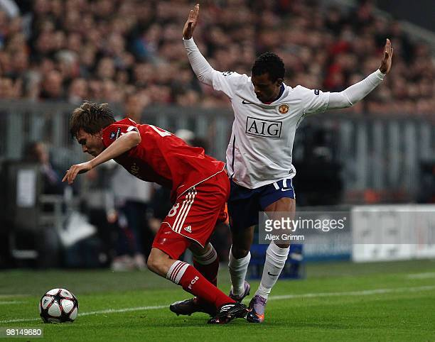 Holger Badstuber of Bayern Muenchen is challenged by Nani of Manchester United during the UEFA Champions League quarter final first leg match match...