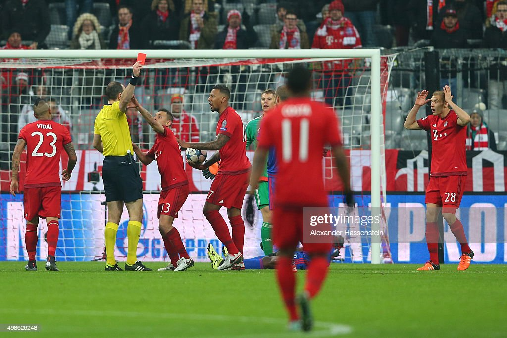 Holger Badstuber of Bayern Muenchen is shown the red card by referee Jonas Eriksson during the UEFA Champions League group F match between FC Bayern Munchen and Olympiacos FC at the Allianz Arena on November 24, 2015 in Munich, Germany.