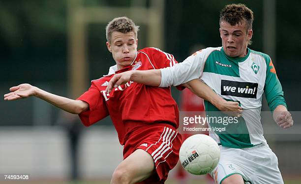 Holger Badstuber of Bayern tussles for the ball with Alexander Neumann of Werder during the A Juniors semi final match between Werder Bremen and...
