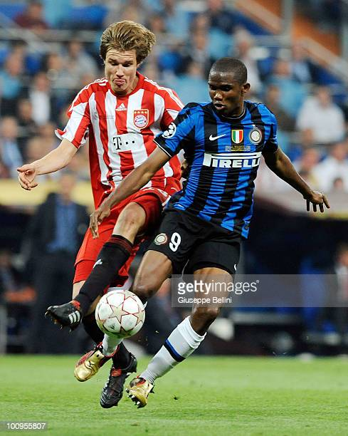 Holger Badstuber of FC Bayern Muenchen and Samuel Eto'o of Inter Milan in action during the UEFA Champions League Final match between FC Bayern...