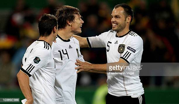 Holger Badstuber of Germany celebrates scoring the fourth goal with Heiko Westermann during the EURO 2012 Group A Qualifier match between Germany and...