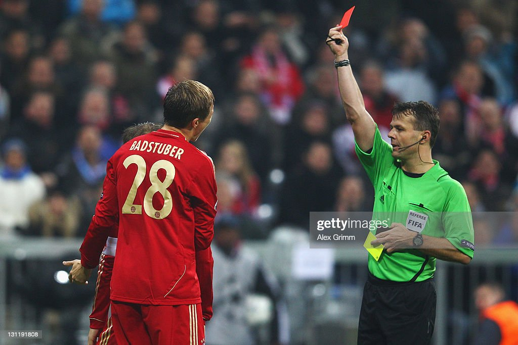 Holger Badstuber of Muenchen is sent off by referee Bjoern Kuipers during the UEFA Champions League group A match between FC Bayern Muenchen and SSC Napoli at Allianz Arena on November 2, 2011 in Munich, Germany.