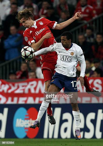 Holger Badstuber of Muenchen jumps for a header with Nani of Manchester during the UEFA Champions League quarter final first leg match between Bayern...