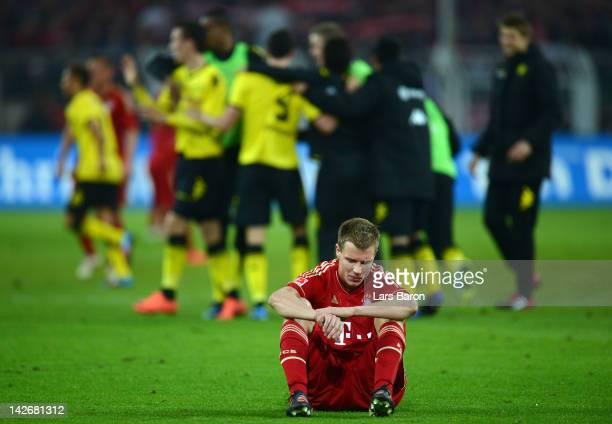 Holger Badstuber of Muenchensits dejected on the pitch after loosing during the Bundesliga match between Borussia Dortmund and Bayern Muenchen at...