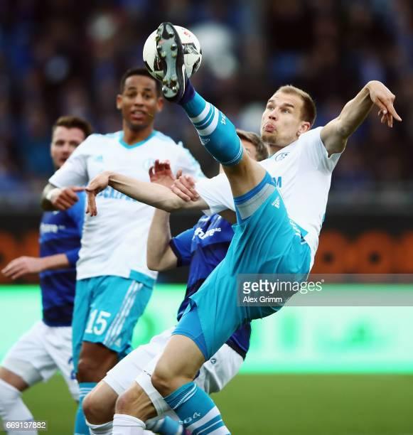 Holger Badstuber of Schalke clears the ball during the Bundesliga match between SV Darmstadt 98 and FC Schalke 04 at Stadion am Boellenfalltor on...