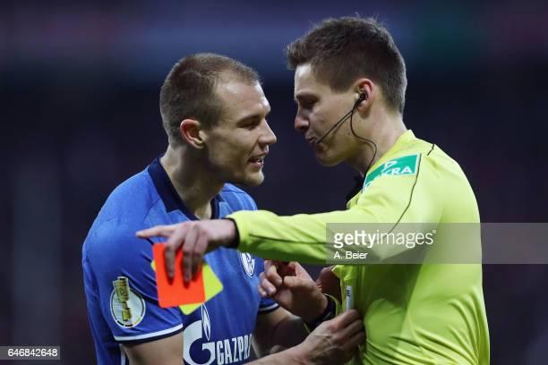 Holger Badstuber of Schalke is sent off by referee Daniel Siebert during the DFB Cup quarter final between Bayern Muenchen and FC Schalke 04 at...