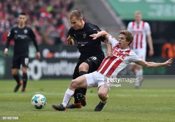 Holger Badstuber of Stuttgart and Vincent Koziello of Koeln battle for the ball during the Bundesliga match between 1 FC Koeln and VfB Stuttgart at...