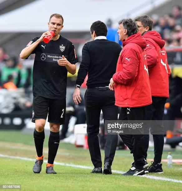 Holger Badstuber of Stuttgart drinks and Head coach Taifun Korkut of Stuttgart walks during the Bundesliga match between 1 FC Koeln and VfB Stuttgart...