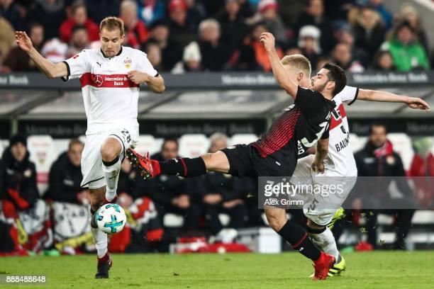 Holger Badstuber of VfB Stuttgart Kevin Volland of Bayer Leverkusen and Timo Baumgartl of VfB Stuttgart battle for the ball during the Bundesliga...