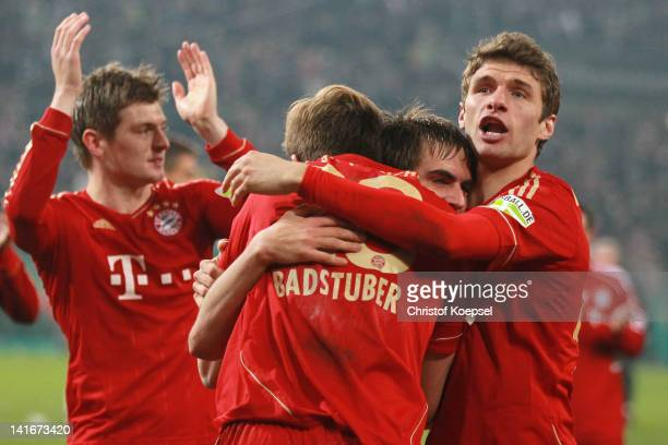 Holger Badstuber Philipp Lahm and Thomas Mueller of Bayern celebrate the 42 victory after penalty shootout after the DFB Cup semi final match between...