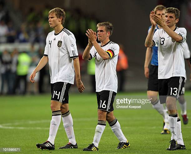Holger Badstuber Philipp Lahm and Thomas Mueller of Germany celebrate the 31 victory after the international friendly match between Germany and...