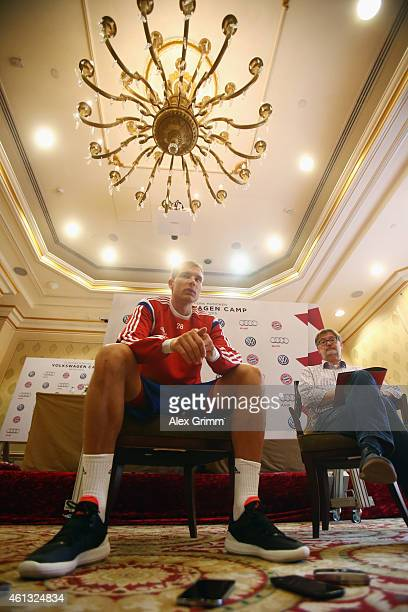 Holger Badstuber talks to the media during day 3 of the Bayern Muenchen training camp at ASPIRE Academy for Sports Excellence on January 11 2015 in...