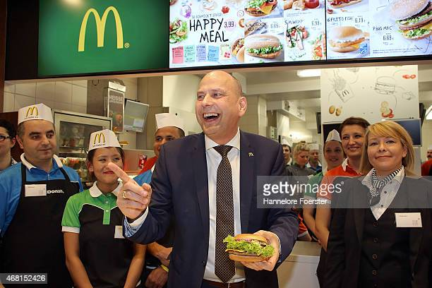 Holger Beeck CEO McDonald's Germany poses with employees during the Reopening of the new McDonald's Flagship Restaurant at Frankfurt International...