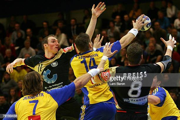 Holger Glandorf and Sebastian Preiss of Germany in action with Magnus Jernemyr and Robert Arrhenius of Sweden during the Men's Handball European...