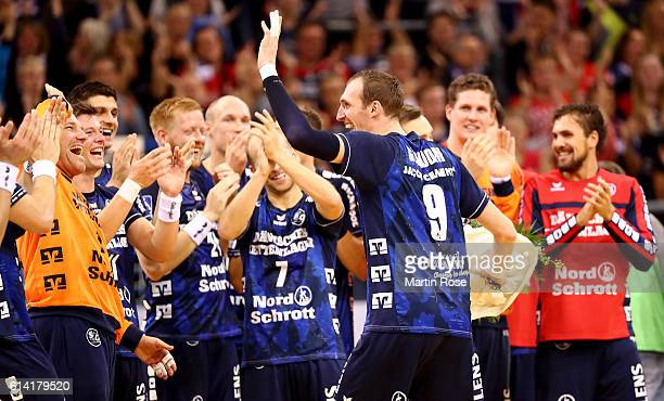 Holger Glandorf of Flensburg celebrate with his team mates after the DKB HBL Bundesliga match between SG FlensburgHandewitt and VfL Gummersbach at...