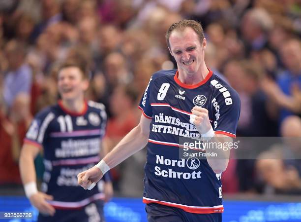 Holger Glandorf of Flensburg celebrates becoming all time top goal scorer in the Handball Bundesliga during the DKB Bundesliga Handball match between...