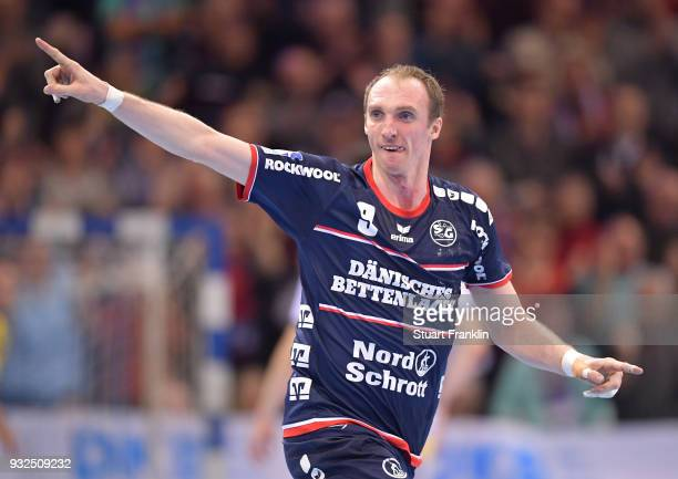 Holger Glandorf of Flensburg celebrates during the DKB Bundesliga Handball match between SG FlensburgHandewitt and Fuechse Berlin at FlensArena on...