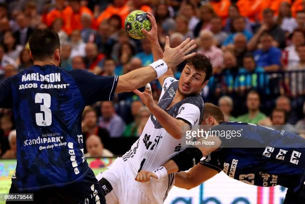 Holger Glandorf of Flensburg challenges Domagoj Duvnjak of Kiel for the ball during the Rewe Final Four final match between SG FlensburgHandewitt and...