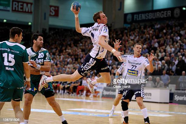Holger Glandorf of Flensburg controls the ball during the Toyota HBL match between SG FlensburgHandewitt and HSG Wetzlar at Campus hall on October 8...