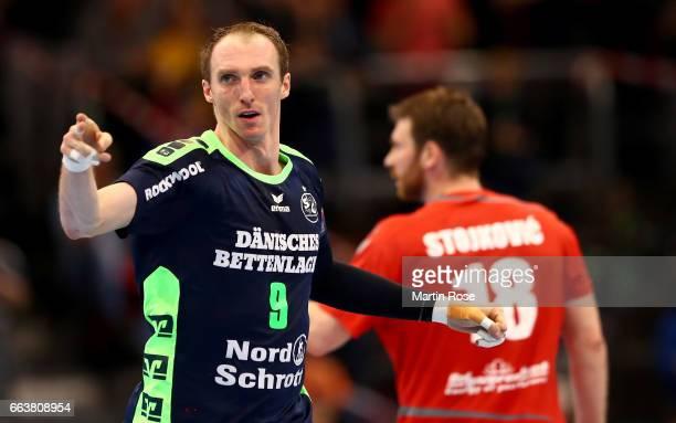 Holger Glandorf of Flensburg Handewitt celebrates after scoring during the Velux EHF Champions League round of 16 second leg match between SG...