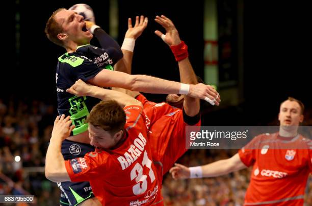 Holger Glandorf of Flensburg Handewitt challenges Simon Razgor of Brest HC Meshkov for the ball during the Velux EHF Champions League round of 16...