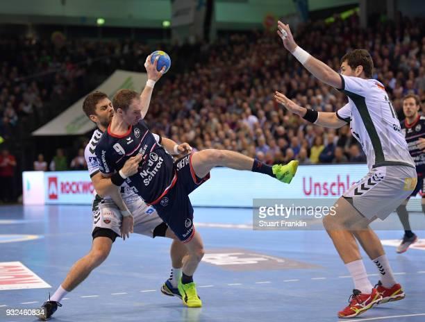 Holger Glandorf of Flensburg is challenged by Drago Vukovic of Berlin during the DKB Bundesliga Handball match between SG FlensburgHandewitt and...