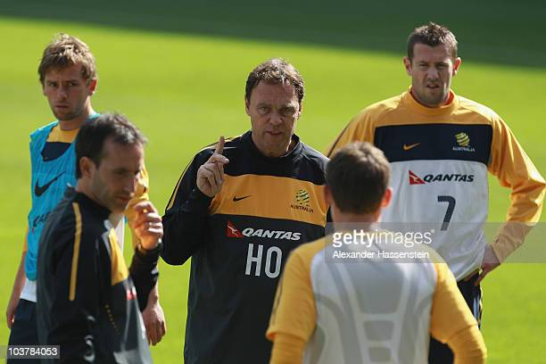 Holger Osieck head coach of team Australia gives instructions to his players during an Australian Socceroos training session at the AFG Arena on...