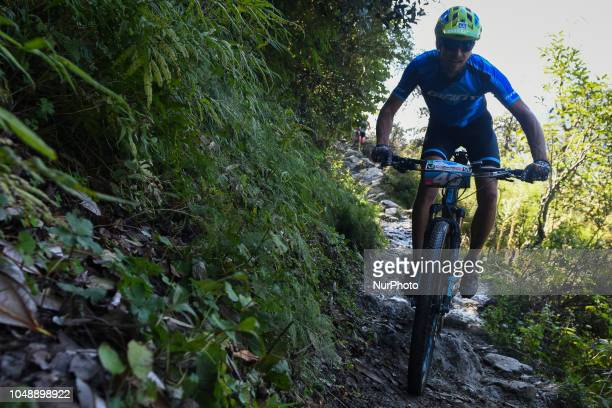 Holger Schaarschmidt of Germany competes in the 14th edition of the Hero MTB Himalaya mountain bike race in the northern Indian state of Himachal...