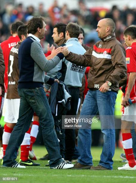 Holger Stanislawski , head coach of St. Pauli and Claus Dieter Wollitz , head coach of Cottbus shake hands after the Second Bundesliga match between...