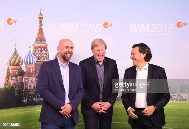 Holger Stanislawski Oliver Kahn and Urs Meier pose for a picture during the ARD and ZDF FIFA World Cup presenter team presentation on April 23 2018...
