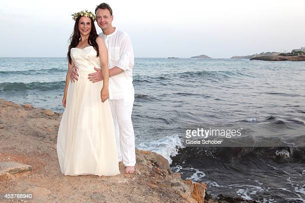 Holger Stromberg and his wife Nikita pose during their wedding on August 9 2014 in Ibiza Spain