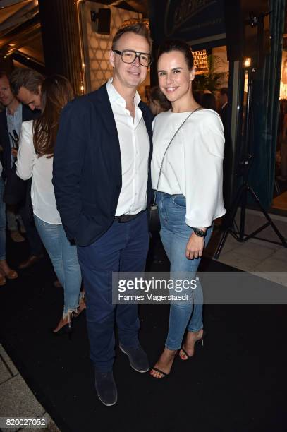 Holger Stromberg and his wife Nikita Stromberg attend the 'Cotidiano Restaurant Opening' on July 20 2017 in Munich Germany