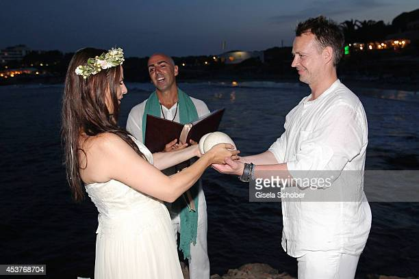 Holger Stromberg his wife Nikita and Melchior during the ceremony of their wedding on August 9 2014 in Ibiza Spain