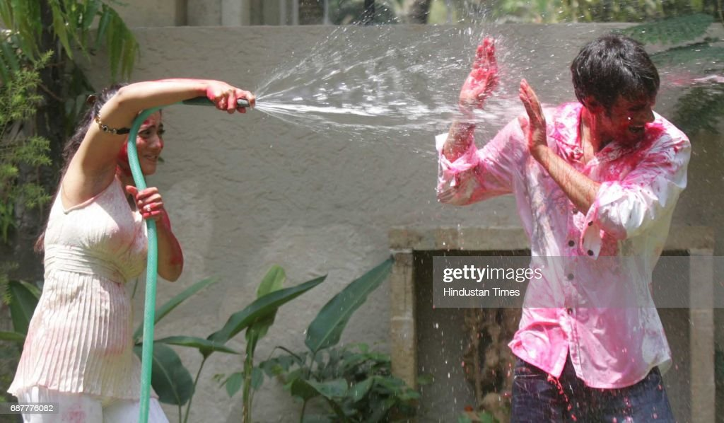 Holi Festival Bollywood actor Ajay Devgan and Kajol play Holi at their residence