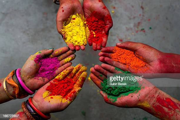holi festival -colors - hands - india - holi stock pictures, royalty-free photos & images