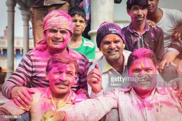 holi festival india celebrating indian men at holi festival - mlenny stock pictures, royalty-free photos & images