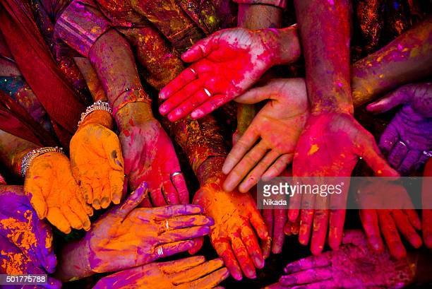 holi festivalhands in india - color image stock pictures, royalty-free photos & images