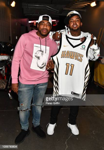 Holiday and Lil Scrappy backstage during The Detroit Pistons vs Atlanta Hawks Game at State Farm Arena on November 9 2018 in Atlanta Georgia