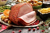 Holiday baked Ham with sides  / Xmas Dinner  table setting, selective focus