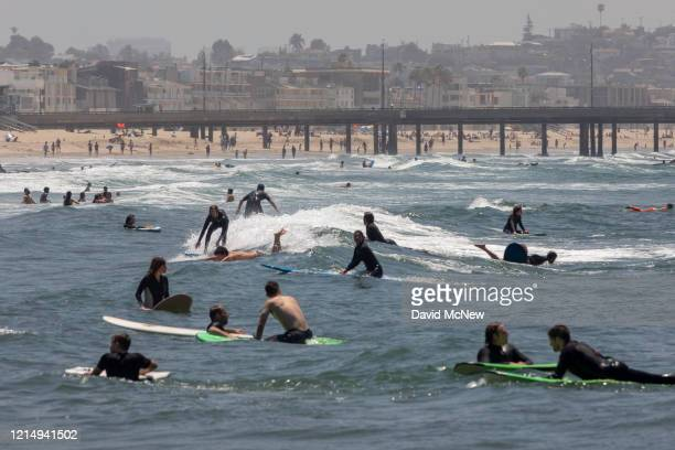 Holiday beachgoers head to Venice Beach on Memorial Day as coronavirus safety restrictions continue being relaxed in Los Angeles County and...