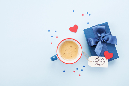 Holiday breakfast on Happy Fathers Day with coffee, gift box and heart on table top view. 963284636